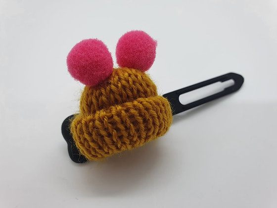 Golden Woolly Bobble Hat on a Black 4.5 Bow clip