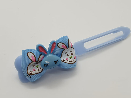 Blue Easter Bunny Face on a Bunny Patterned Bow on a Blue 4.5 Clip