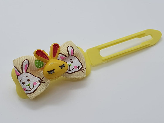 Yellow Easter Bunny Face on a Bunny Patterned Bow on a Pale Yellow 4.5 Clip