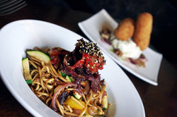 Chilli beef noodles and croquettes