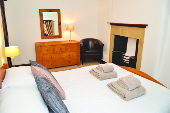 A bedroom at Harrow Cottage