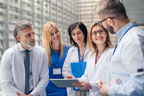 group-of-doctors-on-conference-medical-team-standing-and-discussing-issues.jpg