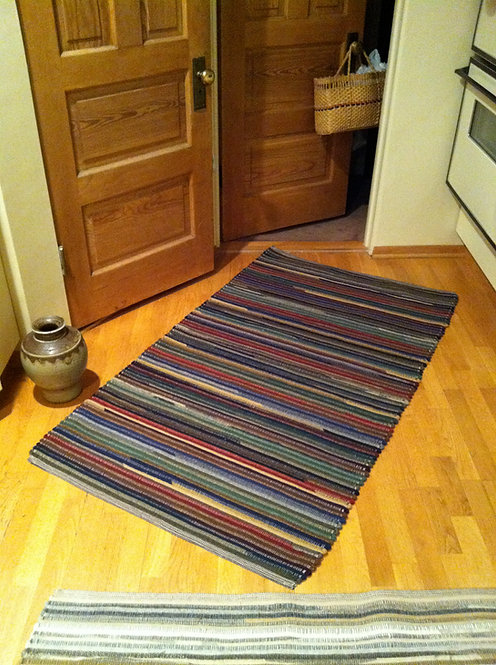 Handwoven wool rug 2 x 3 dark multi