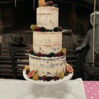 3-tier semi-naked cake with edible leaf