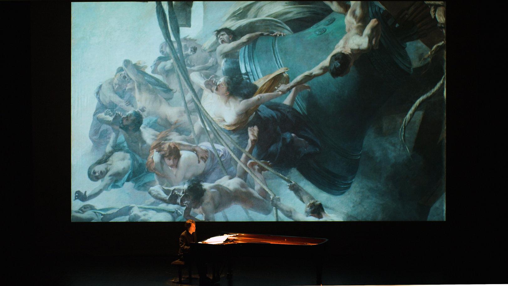 Bertrand Coynault joue le spectacle Les Toiles Musicales, la rencontre de la musique et de la peinture. Les voix du tocsin d'Albert Maignan.