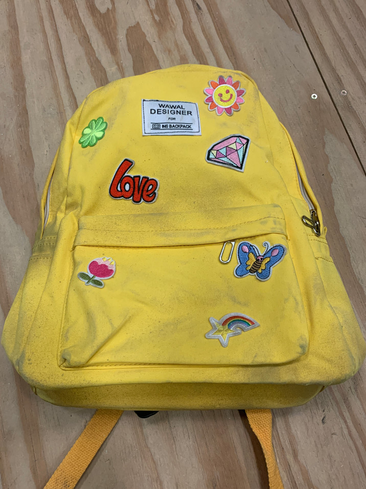 Distressed and Patched Backpack
