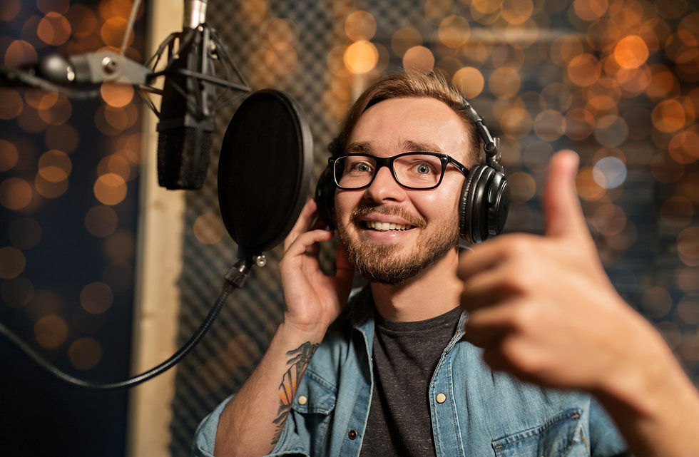 music, show business, people and voice concept - male singer with headphones and microphon