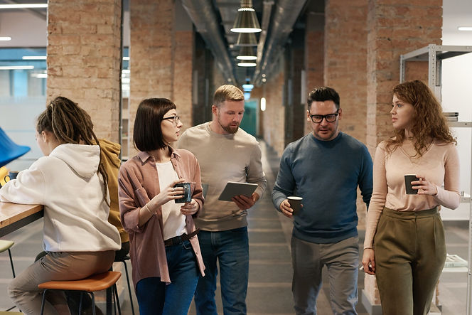 photo-of-people-walking-on-hallway-31827