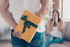 Focus on a yellow gift box, shocked brun