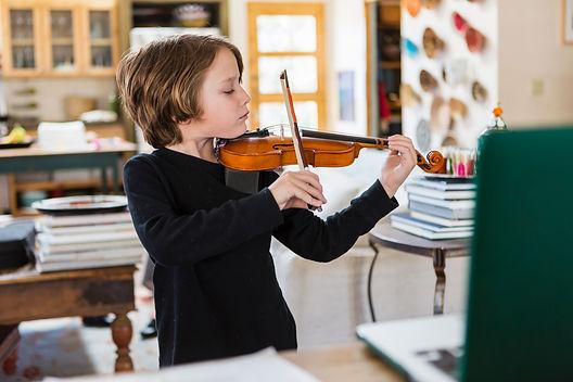 six-year-old-boy-playing-violin-having-a