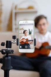 boy-student-recording-video-of-his-guita