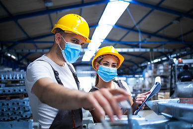 industrial-workers-with-face-masks-prote