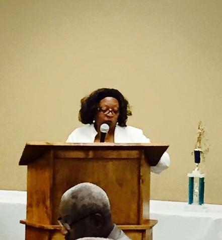 Mrs.LaLaura Wayland, Alumni Association President speaking to banquet guests