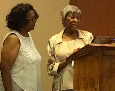 "Mrs. Helen Becks presenting Mrs. LaLaura Wayland the ""Merit of Excellence Award"" from the Booker T. Washington Alumni Association Board of Directors."