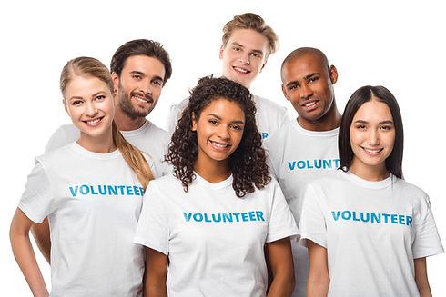 happy multiethnic group of volunteers is