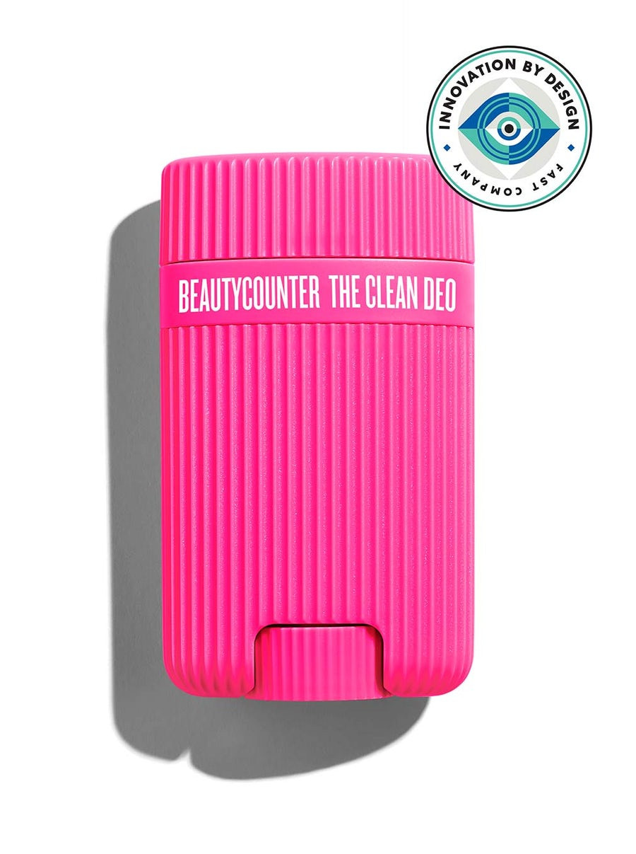 A hot pink container of Beautycounter Clean Deo, which is cylindrical and textured
