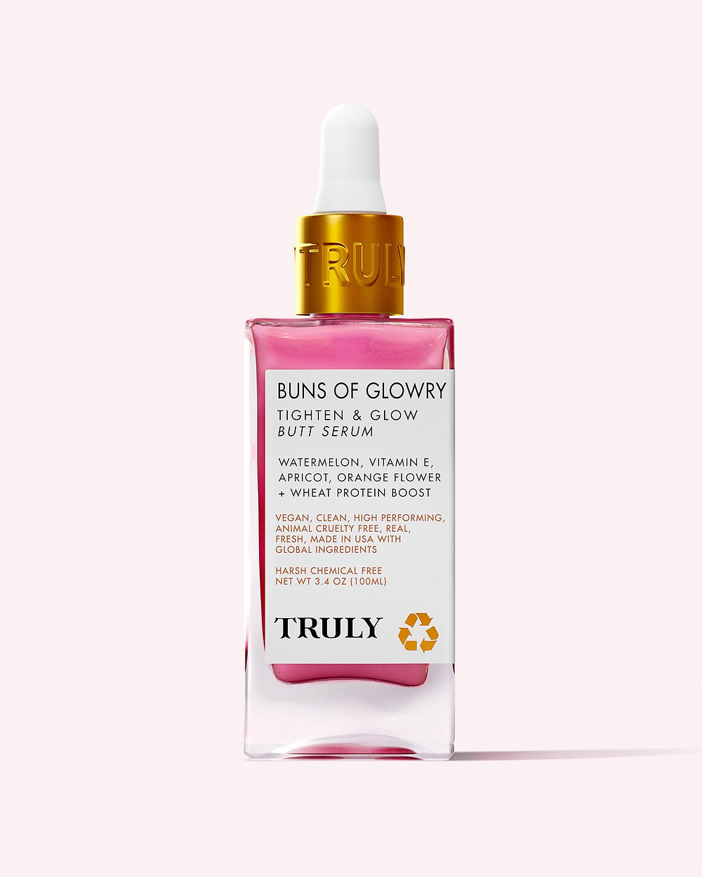 A glass bottle of Truly Beauty Butt Serum, which is vibrant fuschia pink