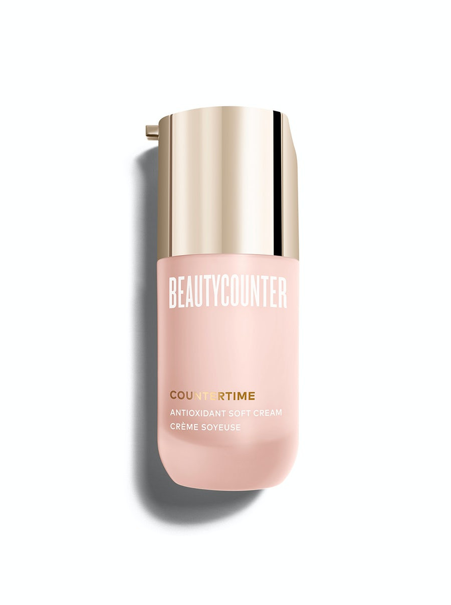 A powdery pink container of Beautycounter antioxidant cream with a gold-tone pump