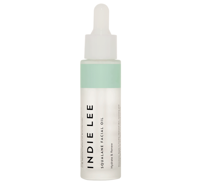 A glass bottle of Indie Lee Squalane facial oil