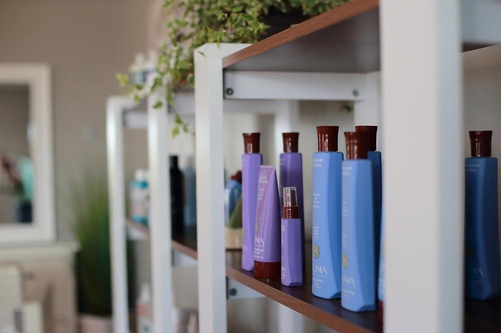 Hair products, like shampoo, line the salon shelves