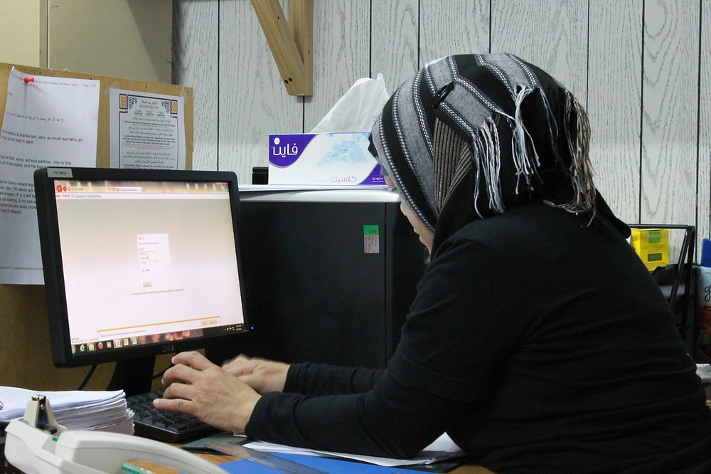 A woman doing work at a computer