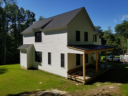 combination of horizontal & vertical siding and a covered porch to add a welcoming feelings