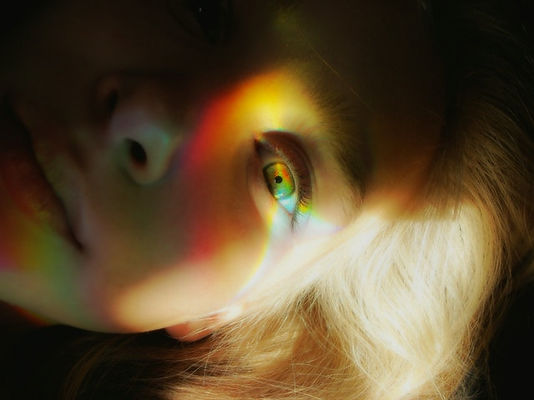 woman-s-face-with-light-reflections-3431