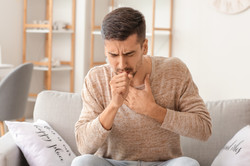 Coughing young man at home.jpg