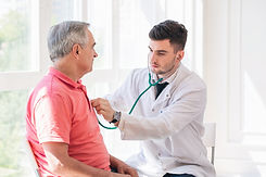 Senior man being examined by a doctor..j