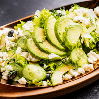 DOORS' Avocado Salad served with, cucumber, blueberry and apple dressing  designed to tease the taste buds and whet one's appetite