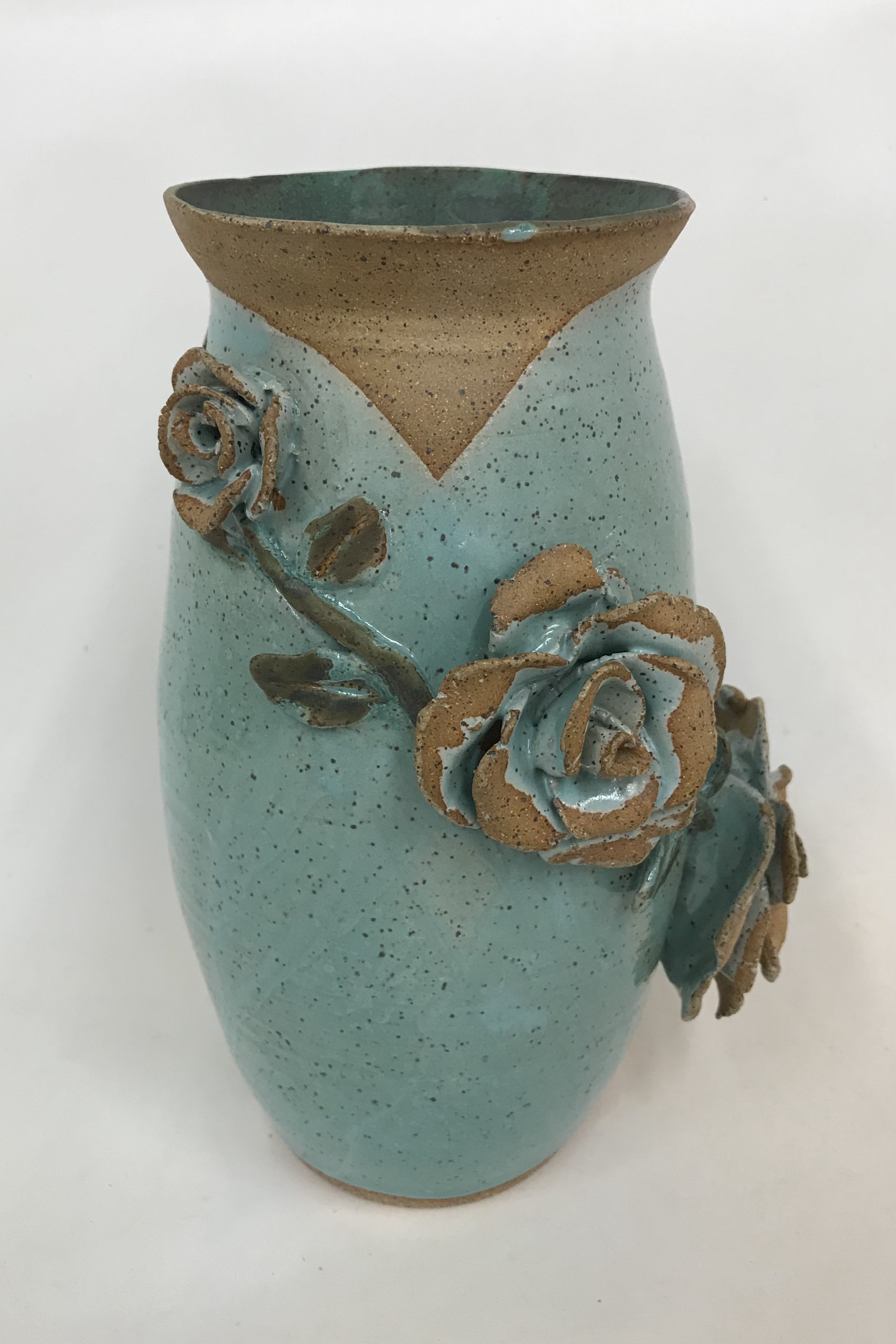 green vase with roses