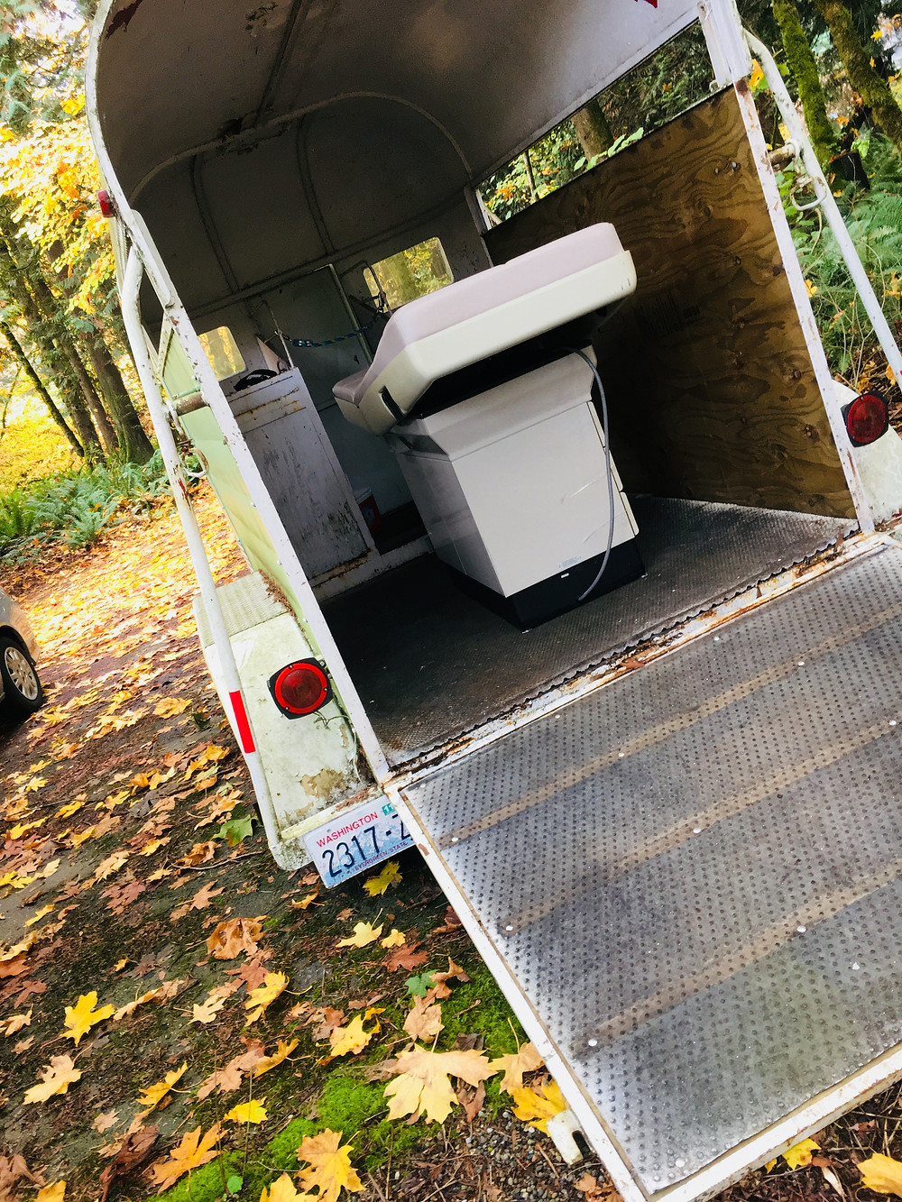 Oodle Family Medicine's exam table fits in a small horse trailer!