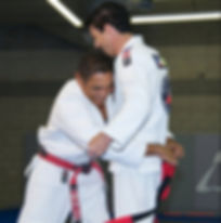 Master Jean Jacques Machado promoted to coral belt by his cousin and mentor Master Rickson Gracie