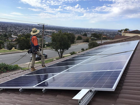 Solar panels on a roof being installed by Adelaide solar installer