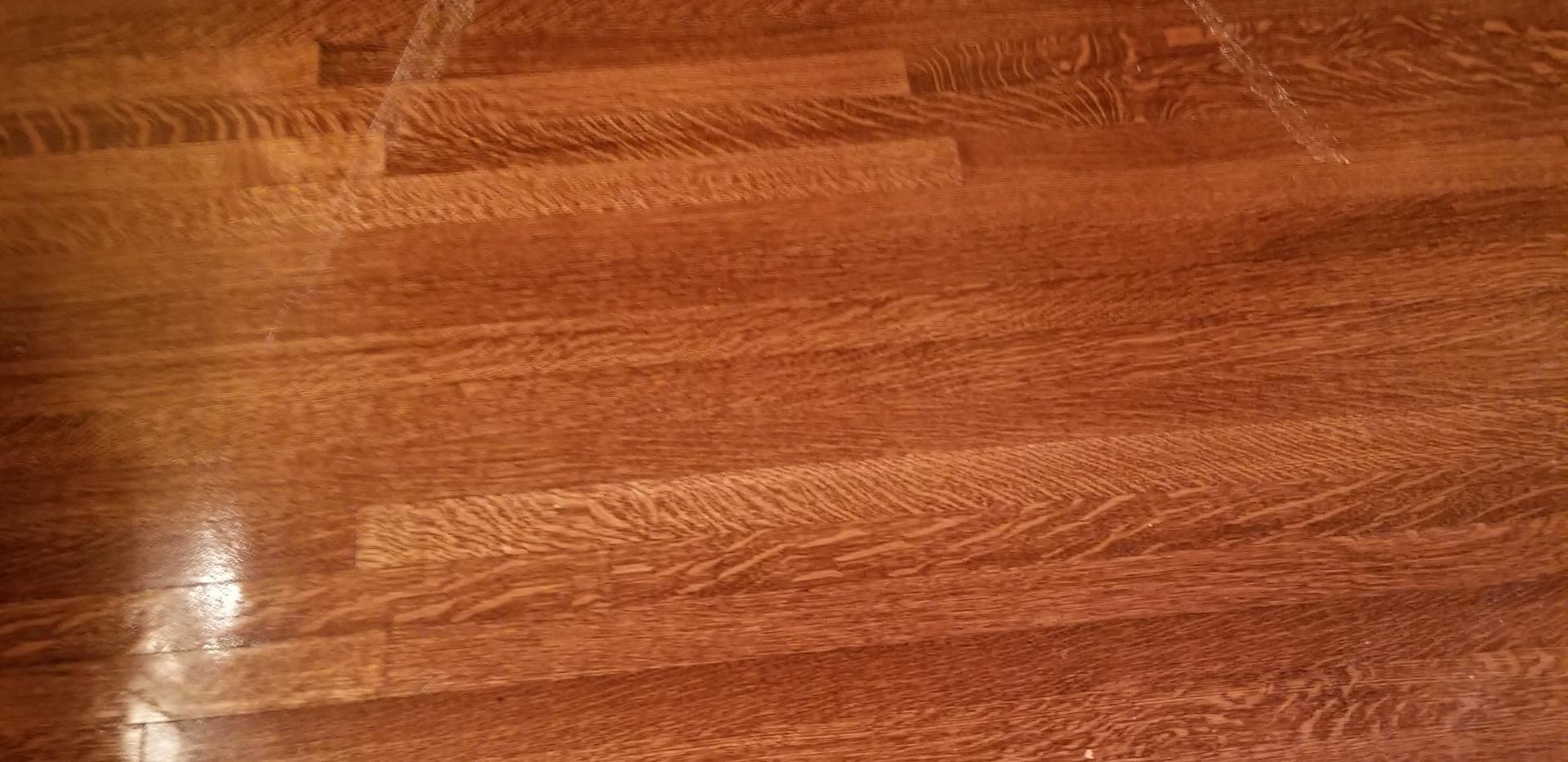 scratches in hardwood floor due to water leak on 2nd floor