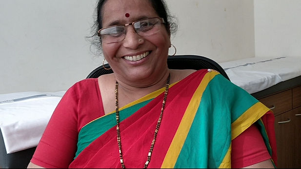 Patient Sushilaben is happy after Spine Surgery