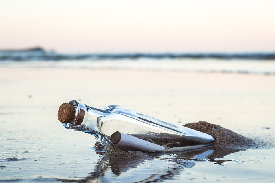 Message in a bottle with beach.jpg