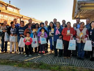 Familias de Queilen aprenden a ahorrar energía y reciben kits de ampolletas eficientes