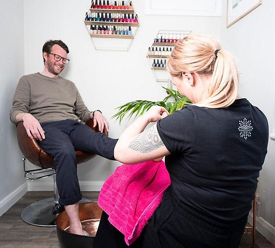 Man having a foot scrub