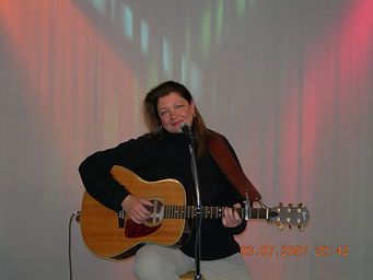 Copy of Kelly with guitar.JPG