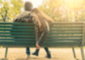 Couple on a bench - Two lovers sitting o