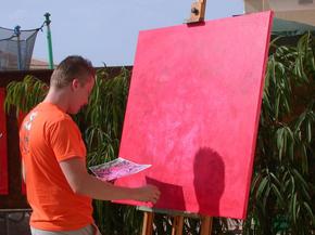 Son Jocko Painting in the garden