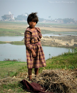 Girl Collecting Straw