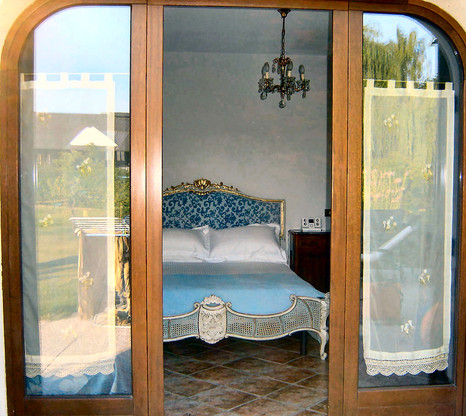 Downstairs Bedroom Open Onto Gardens.jpg