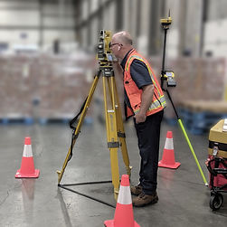 Surveyor with Topcon Total Station
