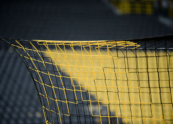 yellow black corner from the goal net So