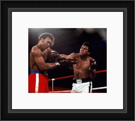 Ali punches Foreman
