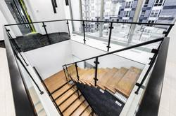 wood stairs black steel railing