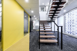 office stairs yellow paint