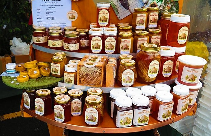 norbs-gold-raw-honey-market-stand.jpg